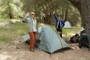 Happy Backpackers with Tent
